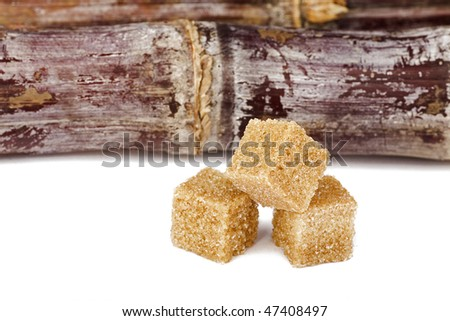 brown sugar with sugar cane isolated on white - stock photo