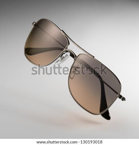 brown sunglasses - stock photo