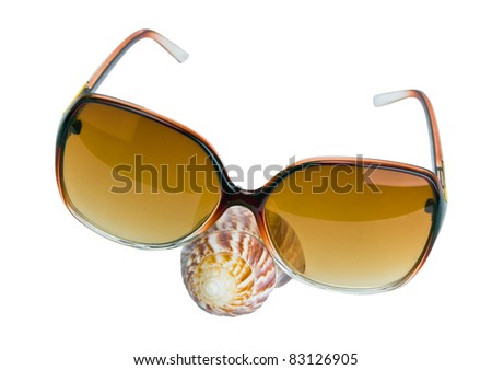 Brown sunglasses with seashell nose isolated on the white - stock photo