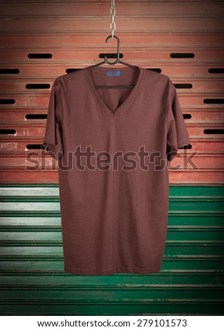 Brown t-shirt hanging on steel Door