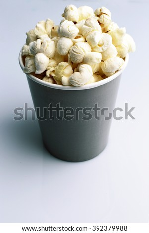 Brown tall bowl with popcorn isolated on white - stock photo