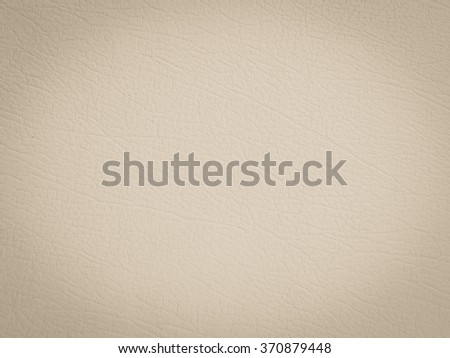 brown/tan/cream/beige color leather texture background with vignette:wrinkle of genuine skin backdrop:crinkle of pure cowskin wallpaper for design,decorate,banner,template:cropped image. - stock photo