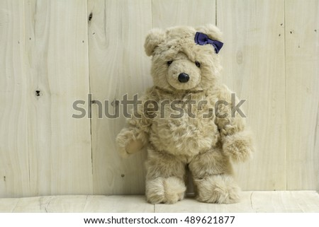 Brown teddy bear on wooden floor