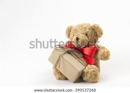 Brown teddy bear, red bow tie with gift box paper red heart on white background.