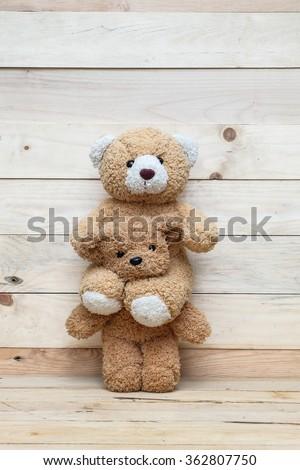 brown teddy bear sitting on  neck teddy bear - stock photo