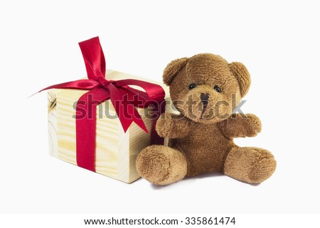 brown teddy bear with Gift wooden box isolated on white background