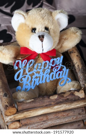 Brown teddy bear with happy birthday sign - stock photo