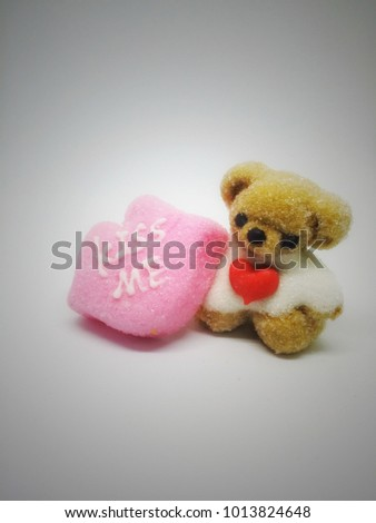 Brown Teddy bear with red heart is a symbol that indicates the expression of love, especially the love day.
