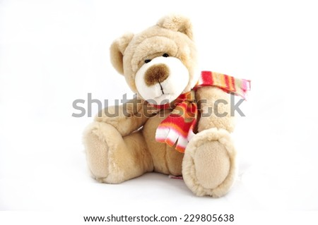 Brown teddy bear with wrap isolated on white - christmas toy - stock photo