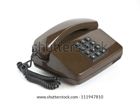 Brown telephone with black buttons isolated on white background - stock photo