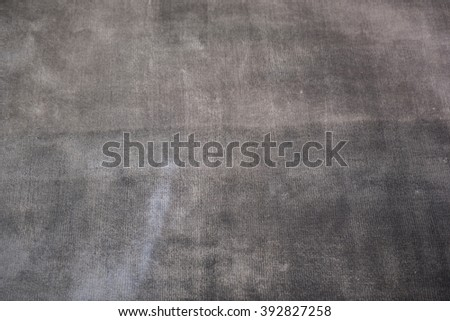 Brown texture from old carpet floor - stock photo
