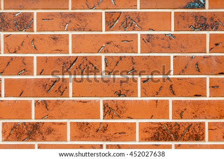 Brown texture tiles under brick background - stock photo