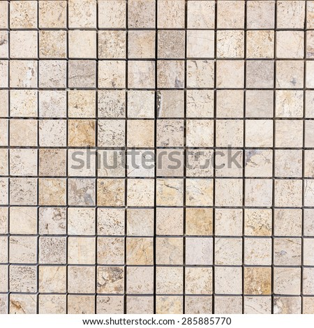 Brown tile on the wall texture and background.