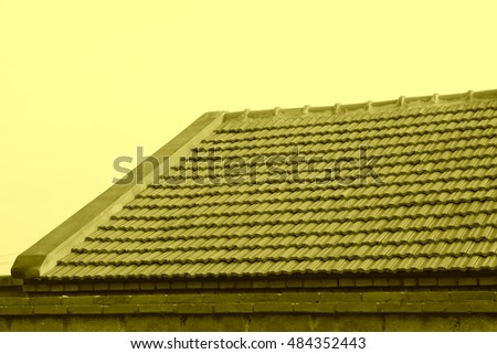 Brown tiles on the roof, closeup of photo