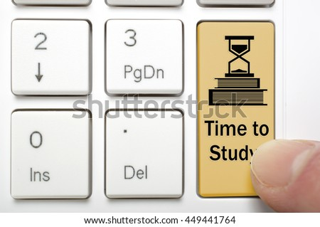 Brown time to study key on keyboard - stock photo