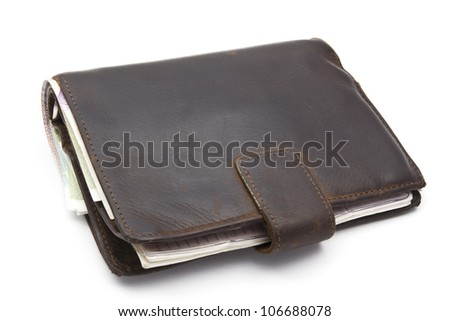 Brown wallet with currency closeup on white background