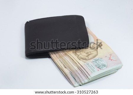 Brown wallet with Thai banknote on white background
