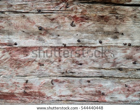 Brown weathered house walls wooden planks surface background with nails