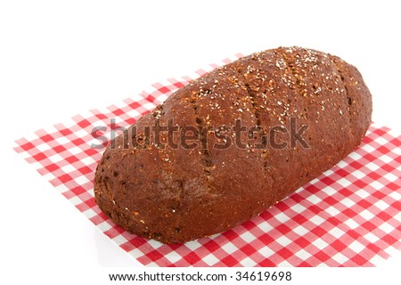 Brown whole meal bread on a checkered cloth
