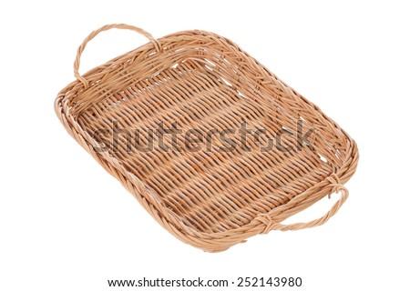 Brown wicker basket on white background - stock photo