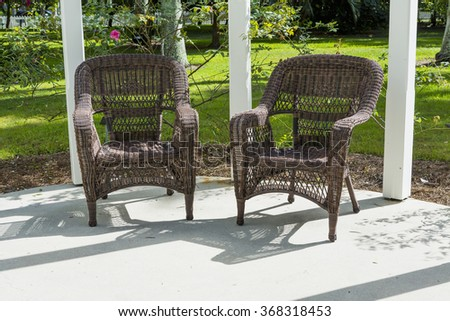 Brown wicker chairs on the terrace. Florida