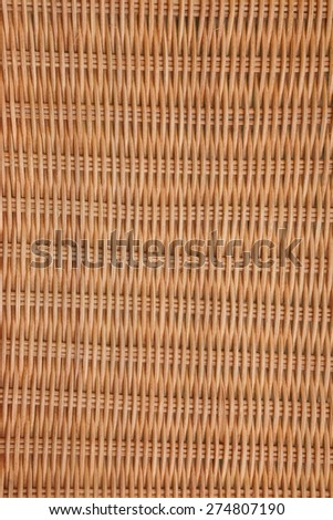 Brown Wicker Rattan Texture Vertical Background Close-up Detail Picnic Basket - stock photo