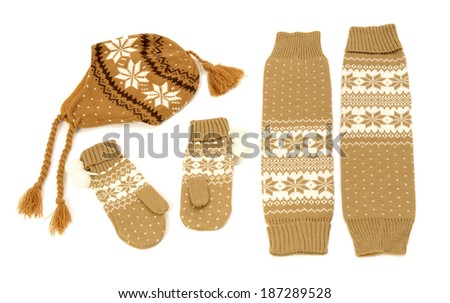 Brown winter accessories isolated on white background. Wool mittens, hat and  leg warmers nicely arranged.  - stock photo