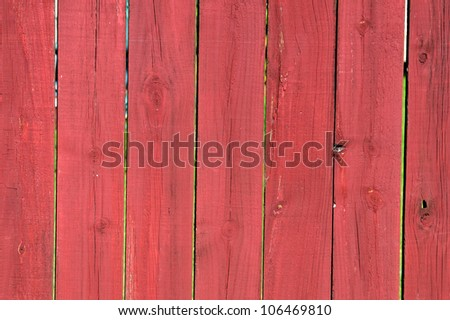 Brown wood fence in a garden. - stock photo