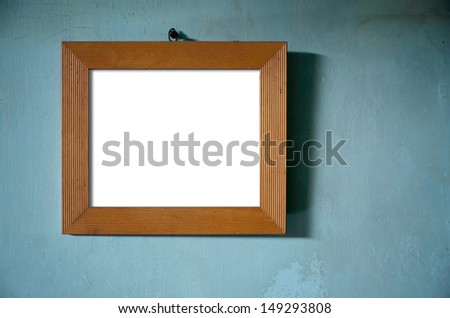 Brown Wood Photo Frame hang on Green old wall - stock photo