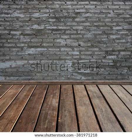 brown wood plank floor with black brick texture wall - stock photo