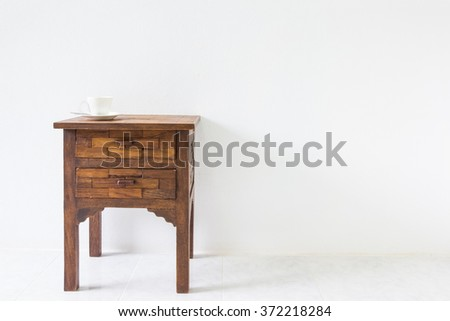 brown wood table in white room.