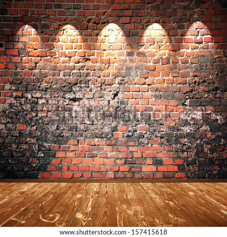 brown wooden floor and brick wall - stock photo