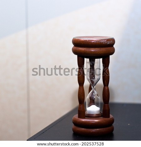 Brown wooden sand clock. - stock photo