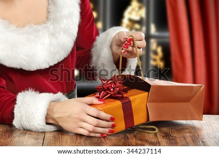 brown wooden table and red window and red woman  - stock photo