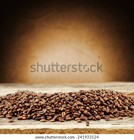 brown wooden table place of coffee beans  - stock photo