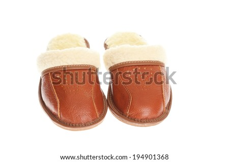 brown wool comfortable slippers - house slipper isolated on white background - stock photo