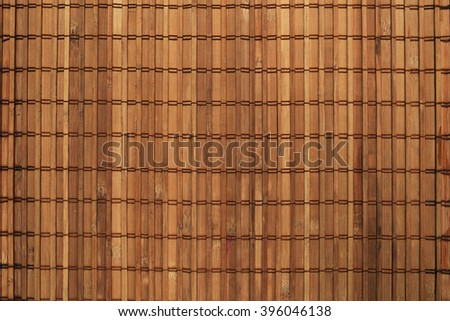 Brown yellow bamboo mat background. Texture closeup. Natural. Useful for designers and photographers. Top view. Vertical - stock photo