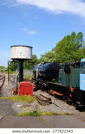 BROWNHILLS, UNITED KINGDOM - MAY 17, 2014 - Small diesel engines and water tower, Brownhills West Railway Station, Staffordshire, England, UK, Western Europe, May 17, 2014.