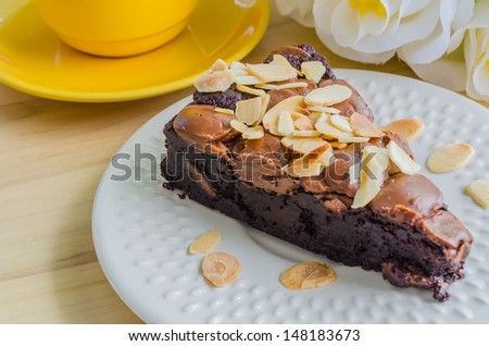 Brownie cake on white dish with almond&chocolate chip