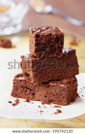 Brownie, closeup chocolate cake on a rustic baking tray, selective focus - stock photo