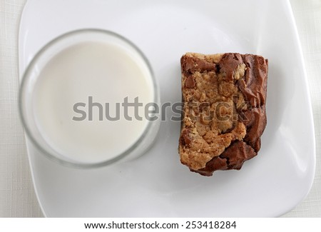 Brownie with a glass of milk - stock photo