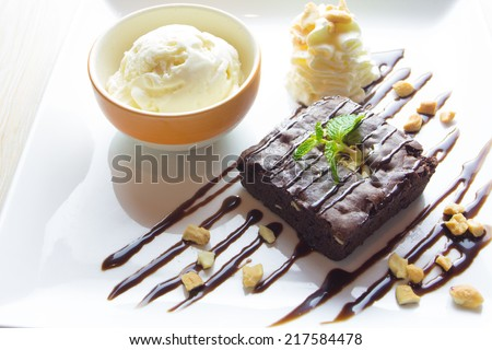 Brownie with ice cream on the dish  - stock photo