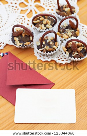 brownies and message on a wooden table - stock photo