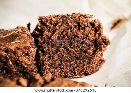 Brownies. Dark Chocolate Brownies, Fresh Baked from Oven, Sliced on Cooking Rack. Homemade Bakery, Pastry and Dessert. Rustic Still Life Style. Background and Textures, Close up Selective. - stock photo