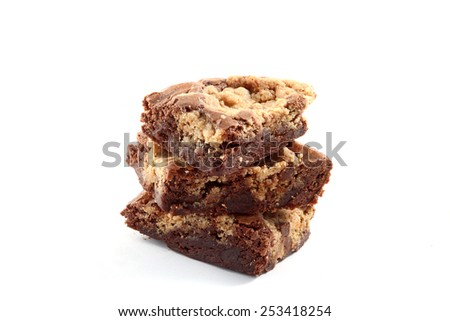 Brownies in a stack over a white background. - stock photo