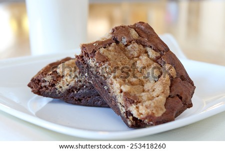 Brownies on a plate with glass of milk. - stock photo