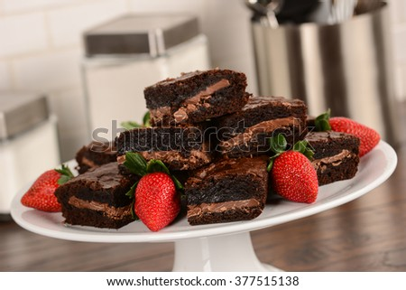 Brownies On Counter top with Strawberries
