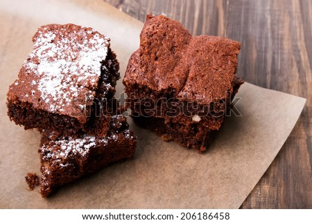 Brownies on the wooden table close-up - stock photo