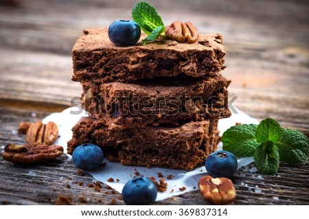 Brownies on wooden background  - stock photo