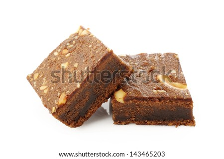 Brownies with cashew nuts on white background